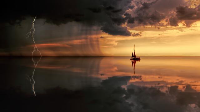 boat floating in stormy seas