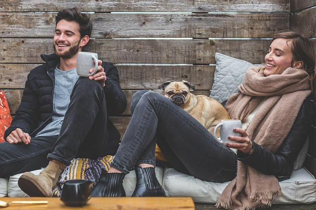 happy couple with pug